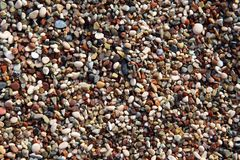 Texture of colored sea sand close-up