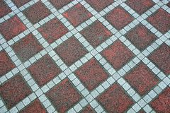 Texture of a colored square old paving slab on the road Royalty Free Stock Images