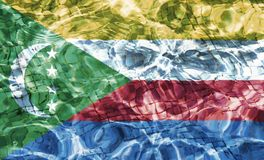 Texture of Comoros flag. Texture of Comoros flag in the pool, water. Splashes Royalty Free Stock Photo