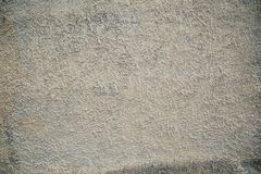 Texture of concrete and plaster on the wall. Stains on the wall. Small waves. Wavy lines in the plaster. Three-dimensional texture. Texture of concrete and royalty free stock images