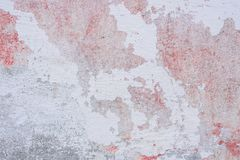 Texture of a concrete wall with cracks and scratches which can be used as a background. Texture, wall, concrete, it can be used as a background. Wall fragment royalty free stock photos