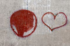 Texture of a concrete wall with a painted heart. stock image
