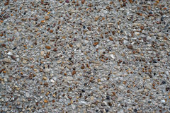 Texture concrete wall with pebbles Stock Photos