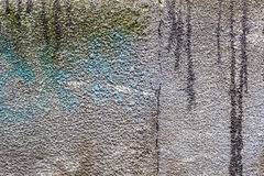 Texture concrete wall with spots of blue paint and dirty streaks. Abstract background Royalty Free Stock Photos