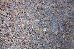 Texture of concrete wall with stones Stock Images