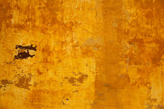 The texture of the concrete walls are painted in orange-yellow Royalty Free Stock Image