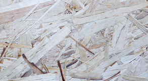 Texture of construction material sheet OSB. Background of texture of construction material sheet OSB royalty free stock photography