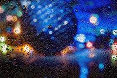 Texture a cor com bokeh, gotas da água no vidro fotografia de stock