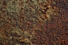 Texture of corrosion. The detailed texture of corrosion on the painted metal surface Stock Photo