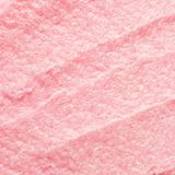 Texture cosmetic scrub for face and body pink sugar. Selective focus, trendy punchy pastel background. stock photography