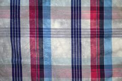 Texture of cotton fabric with a tartan pattern. Texture of cotton fabric with a pattern of gray, blue and red tartan Royalty Free Stock Photo