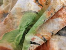 Texture of cotton fabric with pleats in beige and green tones Royalty Free Stock Photography