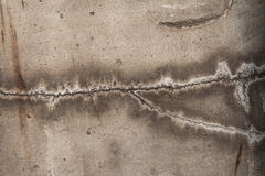 The texture of the crack on the concrete wall plaster repair. The texture of the crack on the concrete wall repair old plaster royalty free stock photography