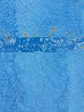 Texture cracked blue paint wall. Old cracked blue paint on wall background Royalty Free Stock Photography