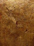 Texture criquée d'or sur la roche Photo libre de droits