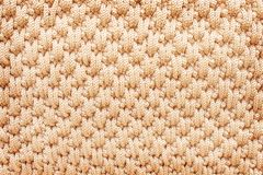 Texture crochet knitted patterns background,light brown royalty free stock photo