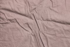 Texture of crumpled bed linen. Texture of crumpled cotton bed linen. Textile background stock image