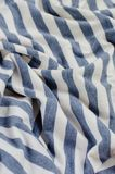 Texture of Crumpled Blue and White Striped Fabric. Royalty Free Stock Images