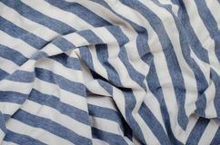Texture of Crumpled Blue and White Striped Fabric. Stock Photography
