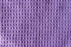 The texture of a crumpled colorful lilac violet color fabric texture background. The texture of a crumpled colorful lilac violet color fabric background. Weaved stock photos