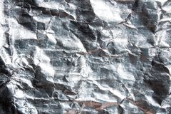 Texture of crumpled foil. Background of crumpled silver foil stock photography
