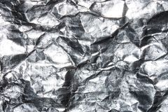 Texture of crumpled foil. Background of crumpled silver foil royalty free stock photo