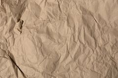 The texture of crumpled paper. The texture of crumpled kraft paper Royalty Free Stock Image