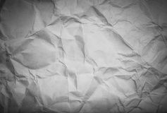 The texture of crumpled paper for background. Toned Stock Photos