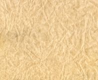 Texture of crumpled paper. Brown crumpled parchment. Stock Photo