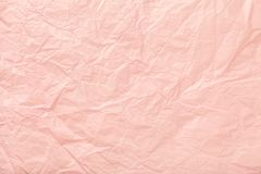 Crumpled pink wrapping paper, closrup. Texture of crumpled pink wrapping paper, closrup. Coral old background royalty free stock image