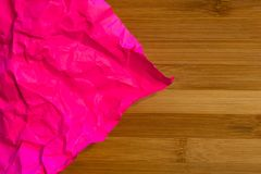 Texture of crumpled sheet of paper on wooden background royalty free stock photos