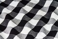 Texture of a crumpled shirt, white black cloth for a background stock images