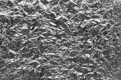 Texture of crumpled tin foil. Monochrome texture of crumpled tin foil for background royalty free stock photo