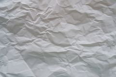 Texture of crumpled white sheet stock photography