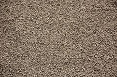 Texture,wall,crushed, stone. Covered wall finish made ??from crushed stone Royalty Free Stock Images
