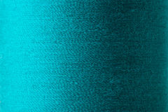 Texture of cyan thread in spool. Cyan thread texture Stock Images