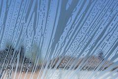 Texture détaillée Modèle et bulles de mousse de savon sur le verre Photographie stock libre de droits