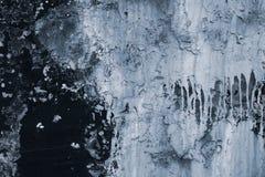 Texture d'éplucher la peinture sur le mur Mur grunge noir avec la peinture grise Fendu du fond de mur abr?gez le fond photographie stock libre de droits