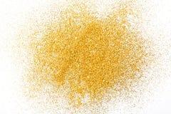 Texture d'or de sable de scintillement sur le fond blanc et abstrait Photographie stock