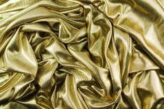Texture d'or de tissu Photographie stock