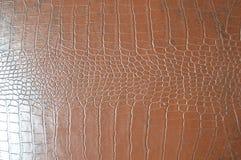 Texture d'imitation de peau de crocodile de Brown photographie stock libre de droits