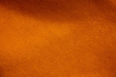 Texture d'un fond orange de tissu photos stock