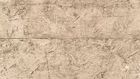 Texture d'un mur en bois avec de l'argile Photos stock