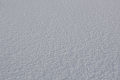 Texture d'un plan rapproché naturel brillant de fond de neige images stock