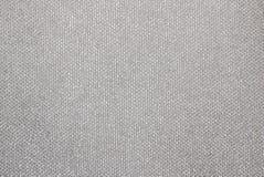 Texture d'un tissu de tapisserie d'ameublement argenté Image stock