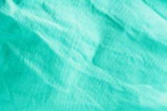 Texture d'une surface verte de fibre de coton formant un tissu, fond abstrait image stock