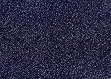 Texture of dark blue cloth with silver and blue sequins Stock Images