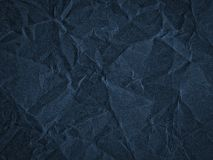 Texture of dark blue crumpled craft paper. Texture for design, abstract background stock photo