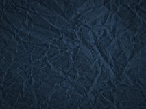 Texture of dark blue crumpled craft paper. Texture for design, abstract background stock image
