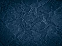 Texture of dark blue crumpled craft paper. Texture for design, abstract background royalty free stock image